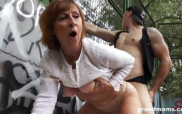 Mature dame is gargling sausage in a public place and getting poked rigid, in comeback